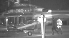 CCTV showing two people and a helicopter