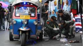 Bomb squad police examine the scene