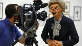 A camera man films the Spitting Image puppet of Margaret Thatcher on display in an exhibition