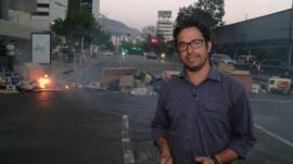The BBC's Vladimir Hernandez in front of a barricade