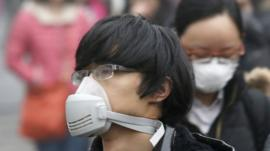 Commuters wearing masks