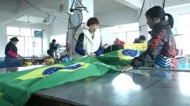 Factory workers making a Brazilian flag