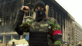 Armed man in uniform in Independence Square
