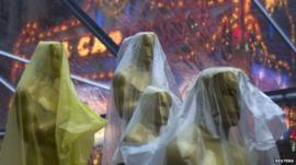 Oscar statuettes covered in plastic sheeting