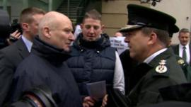 As he arrived to face questions about the scheme, Mr Baggott was met and jeered by loyalist protesters