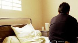 Man sitting on hospital bed