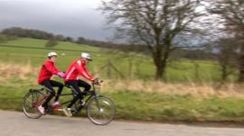 Harry Gration and Amy Garcia cycle though Ilkley on the last training ride for their Sport Relief challenge