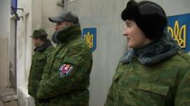Men guarding military hospital