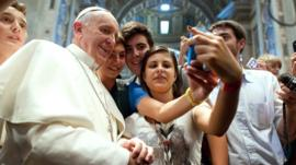 Pope Francis takes a 'selfie' with young Catholics