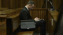 Oscar Pistorius listening to testimony in court in Pretoria