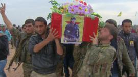 Men carrying a coffin