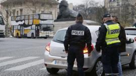 Police with motorist in Paris