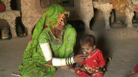 A mother feeding her child in the Thar desert region of Pakistan