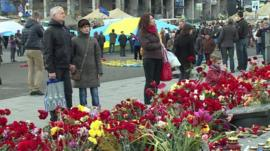 People near flowers