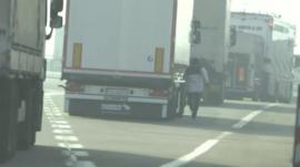 Migrant running towards lorry in Calais
