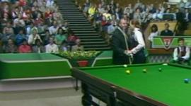 Alex Higgins shakes referee Len Ganley's hand at the Guild Hall