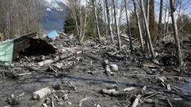 A house is seen destroyed in the mud on Highway 530 next to mile marker 37 on Sunday, March 23, 2014, the day after a giant landslide occurred near mile marker 37 near Oso