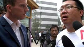 Steve Wang (right) and the BBC's John Sudworth