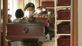 South Korean soldiers carrying coffins