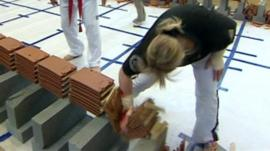 Woman smashing tiles in world record challenge