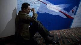 Chinese man in front on MH370 tribute wall
