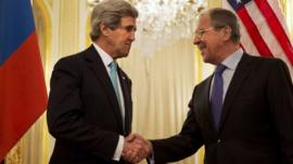 US Secretary of State John Kerry (L) shakes hands with Russian Foreign Minister Sergey Lavrov (R)