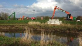 Dredging equipment beside a Somerset river