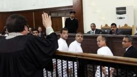 Al-Jazeera staff stand before judge in Egypt trial