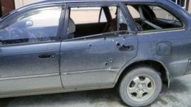 Bullet holes in the car in which the journalists were travelling