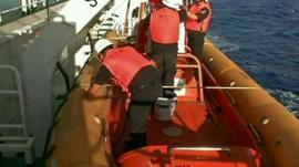 men in lifeboat