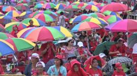 Pro-government supporters with coloured umbrellas in Bangkok