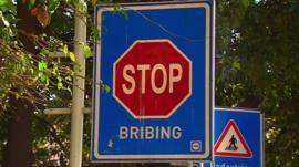 Stop bribing signpost