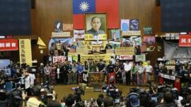 Protesters and banners inside parliament