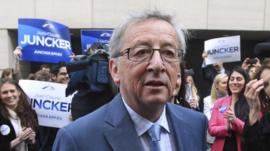 Jean-Claude Juncker, Luxembourg's former prime minister, talks to the media before boarding a campaign bus in Brussels, 8 April