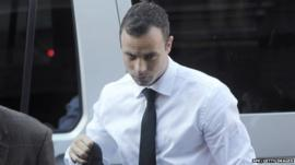 Oscar Pistorius arrives in court on 11 April