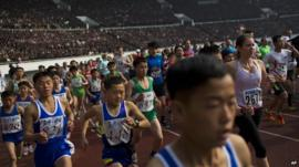 Runners take off inside Kim Il Sung Stadium