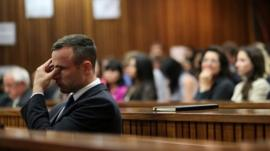 Oscar Pistorius rubs his eye in court in Pretoria, South Africa, Tuesday, April 15, 2014
