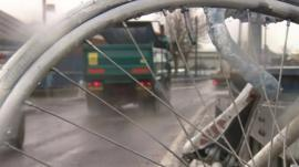 Lorry as seen through spokes of bike