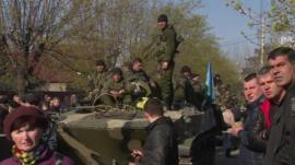 People surround Ukrainian military vehicle