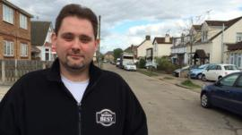 Driver Chris Moore stood in street