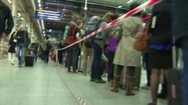 Eurostar passengers queue at St Pancras