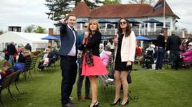 Public enjoy a drink in the sunshine during the All Weather Championships Finals Day at Lingfield Park Racecourse