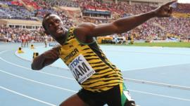 Jamaicas Usain Bolt celebrates after winning the men