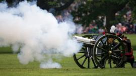 Members of the public watch as the Kings Troop Royal Horse Artillery, fire a 41 Gun Royal Salute performed in honour of Britains Queen Elizabet