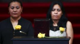 Two women stand behind the urn containing the ashes of Colombian Nobel laureate Gabriel Garcia Marquez
