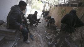 Fighters from the Free Syrian Army in the Mleha suburb of Damascus