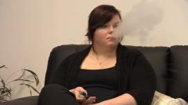 A woman smoking an electronic cigarette