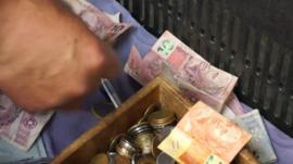 Money in a till in a Sao Paulo market
