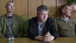 Recent photo of hostages being held in Sloviansk