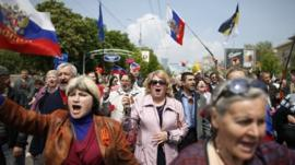 Demonstrators with Russian flags at May Day rally in Donetsk, Ukraine